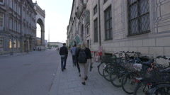 Tourists walking on Residenzstrasse in Munich Stock Footage