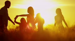 Heterosexual Parents Daughters Sunrise Silhouette Outdoors Loving Casual Leisure - stock footage