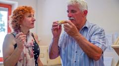 Man tasting bread with organic honey Stock Footage