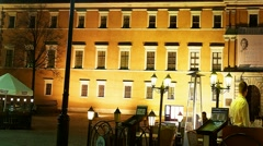 Pan Nightlife in Warsaw People dine in restaurant in front of the Royal Castle Stock Footage