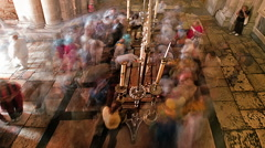 Time lapse of crowds praying at Stone of Anointing. Cropped. Stock Footage