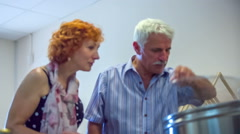 Man showing to his wife how honey is produced Stock Footage