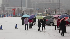 Chinese people in winter snow, Shenyang city Stock Footage
