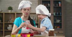 Teaching Kid to Bake Stock Footage