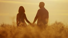 Carefree Caucasian Couple Enjoying Vacation Together Outdoors Sunrise Silhouette - stock footage