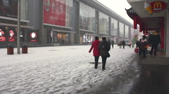 Shenyang city street, winter snow, China Stock Footage
