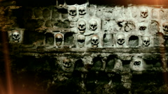 Human skulls walled with stone wall Stock Footage