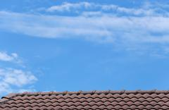 House roof and blue sky. Stock Photos