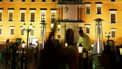 Tilt Nightlife in Warsaw People dine in restaurant in front of the Royal Castle Stock Footage