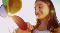 Cute Young Caucasian Girl Playing Outdoors Toy Windmill Clean Environment Energy - stock footage
