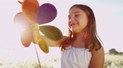 Environment Power Recreation Fun Young Caucasian Girl Playing Rainbow Windmill - stock footage