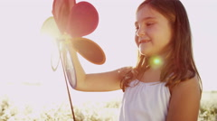 Cute Young Caucasian Girl Playing Outdoors Toy Windmill Clean Environment Energy Stock Footage
