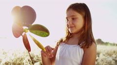 Happy Young Female Child Outdoor Lifestyle Simple Game Windmill Eco Power Motion Stock Footage