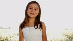 Portrait Happy Smiling Young Girl Child Outdoors Summer Sunshine Stock Footage