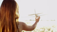 Young Female Caucasian Child Playing Toy Plane Flight Fantasy Outdoors Fun - stock footage