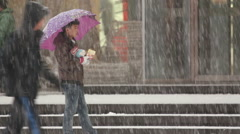 Chinese boy, snow falling, city in China Stock Footage