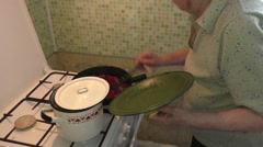 The woman mixs in a frying pan vegetables Stock Footage