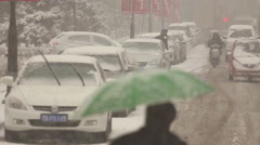 Chinese street during snowstorm, Shenyang Stock Footage