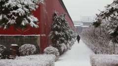 Snowy sidewalk, Chinese red wall, winter Stock Footage