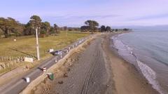 following car along eroded coastal road - stock footage
