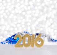 2016 year golden figures and silvery and blue Christmas decorations - stock photo