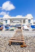 Tourists enjoy the good weather at the beach in Nice, France - stock photo