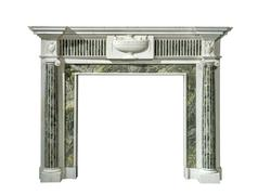 Fire surround in striking green veined marble old Victorian antique isolated Stock Photos