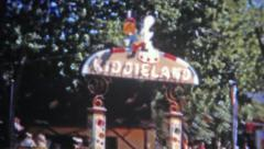 DENVER, COLORADO 1951: Kiddieland Amusement Park girl enjoying the latest rides. Stock Footage