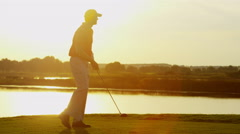 Outdoor Lifestyle Activity Golf Playing Male Caucasian Vacation Sunset - stock footage