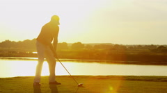 Professional Male Caucasian Playing Golf Commercial Sponsorship Swing Sunrise - stock footage