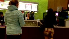 People buying juice at food court inside Coquitlam center mall Stock Footage