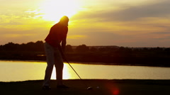 Male Caucasian Professional Golfer Sunset Silhouette Golf Sport Game Lifestyle - stock footage