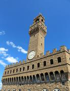 Florence Italy Historic clock tower building and blue sky - stock photo