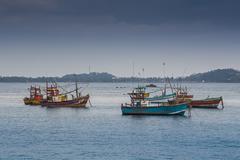 Tired fishing fleet getting back Stock Photos