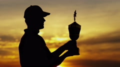 Silhouette Outdoor Winning Tour Lifestyle Golf Playing Male Caucasian Sunset - stock footage