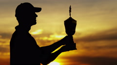 Professional Male Caucasian Winner Golf Sunset Commercial Sponsorship Wealth - stock footage