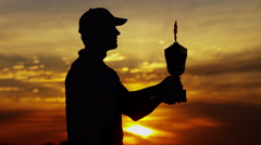 Sunset Golfer Caucasian Male Golf Sport Ceremony Competition Success Trophy Win - stock footage