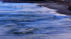 Panning shot of Day time lapse of beach and coastal city Stock Footage