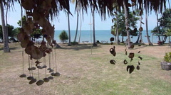 Seashell wind chimes at a tropical bungalow looking out to sea Arkistovideo