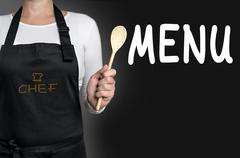 Menu cook holding wooden spoon background - stock photo