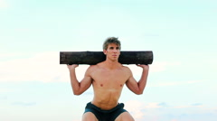 Stock Video Footage of Fit Young Man Exercising on Beach. Crossfit Workout. Training Outdoors. Activ