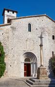 The facade of a medieval church Saint-Pierre-aux-liens Stock Photos