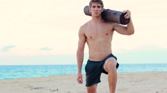 Fit Young Man Exercising on Beach. Crossfit Workout. Training Outdoors. Activ - stock footage