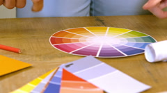 Creative team choosing colours from a colour wheel Stock Footage