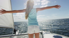 Stock Video Footage of Travel Tourism Advertisement Cute Caucasian Girl Sailing Luxury Boat Ocean Sun