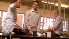 Creative team throwing crumpled balls of paper - stock footage