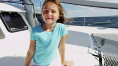 Caucasian Female Child Sailing Yacht Insurance Vacation Sunshine Outdoors - stock footage
