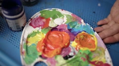 Art brush mixed paint on the palette Stock Footage