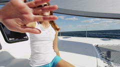 Travel Tourism Advertisement Pretty Teenage Caucasian Girl Luxury Boat Ocean Sun - stock footage