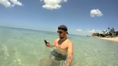 Man Throwing Phone in Sea Water on Vacation. Slow Motion Stock Footage